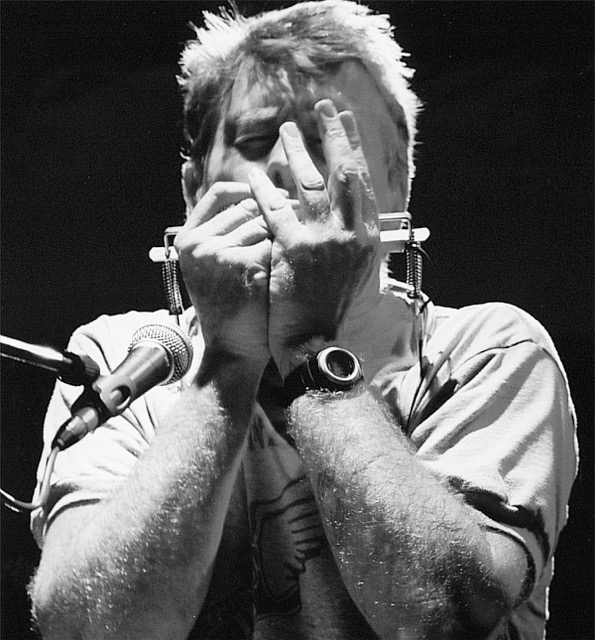 John playing harmonica HI RES-1